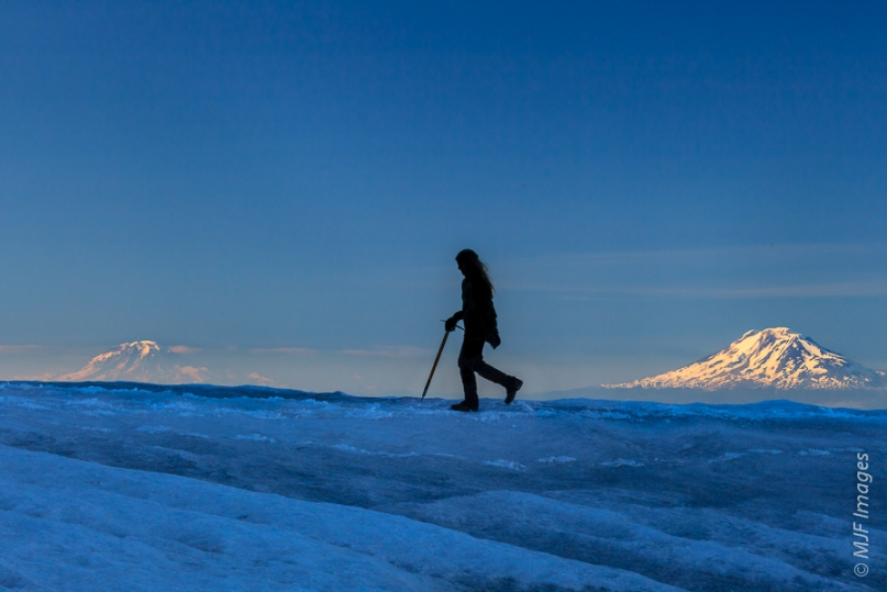 Climbing in the Cascades.  Mount Adams (right) and Rainier are visible.