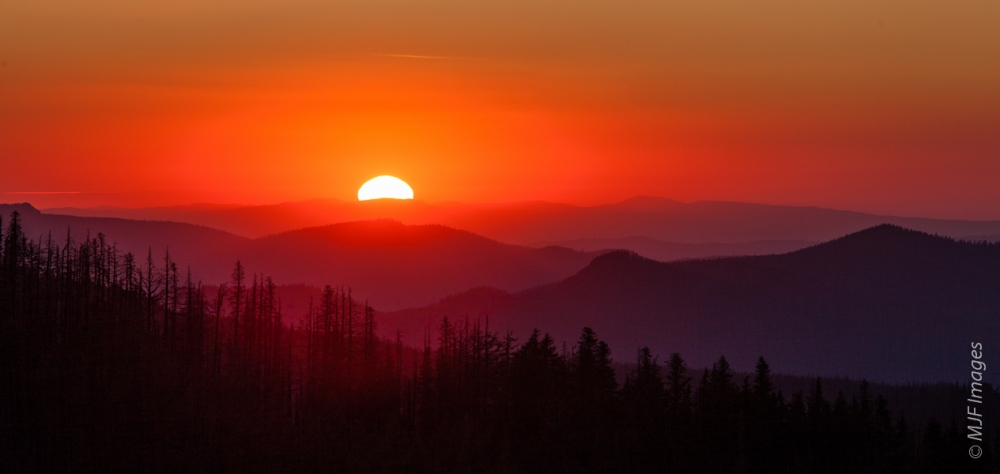 Sunset over the Western Cascades, as viewed from Mount Hood in Oregon.