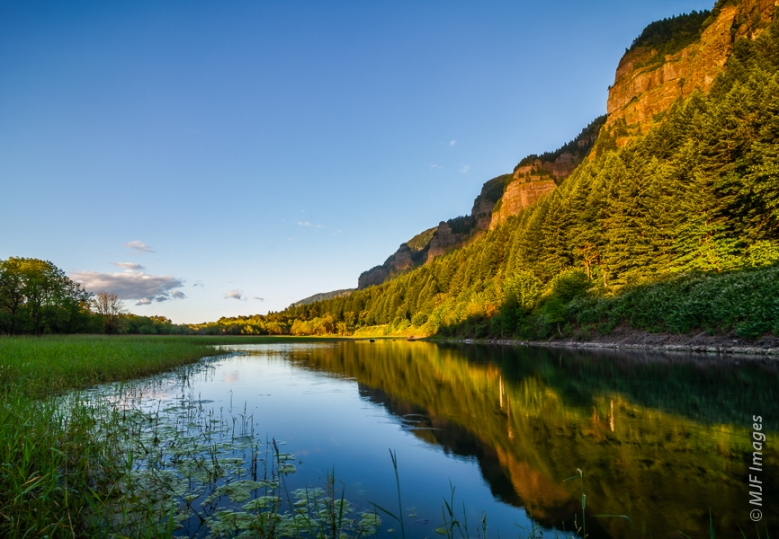 The Columbia River Gorge's high cliffs turn gold at sundown, reflected in wetlands formed during spring's high water flow.  This was captured the day before this camera took a fall.
