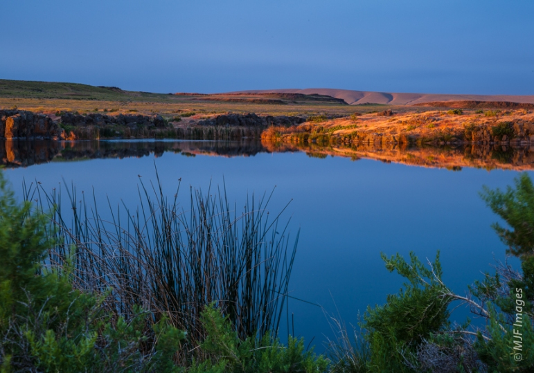 A very calm dawn at Hutchinson Lake in eastern Washington's Columbia National Wildlife Refuge.