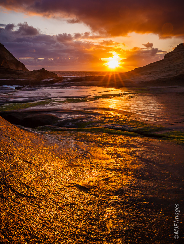 A nice sunset captured earlier this past spring down in one of Cape Kiwanda's rocky inlets.