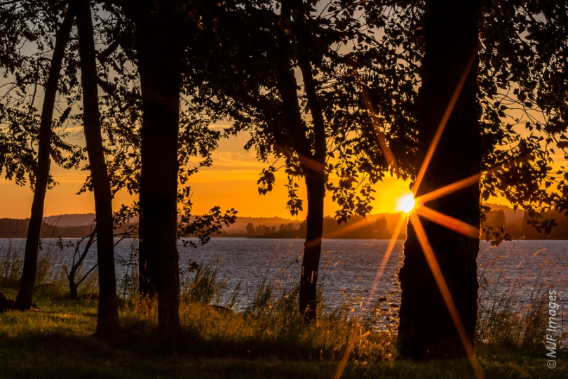 A big sun-star is featured in a recent sunset over the Columbia River in Oregon.