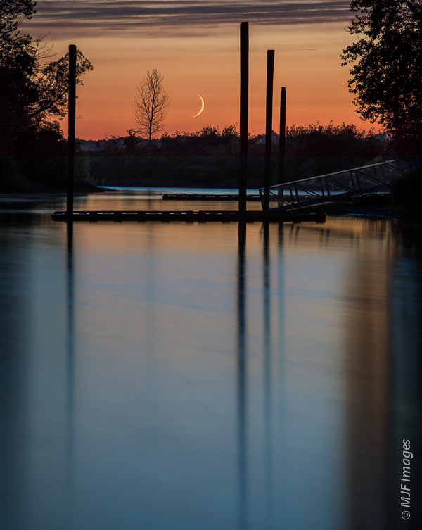 Success!  A peaceful crescent moon sets at dusk over a small inlet of the Columbia River, Oregon.