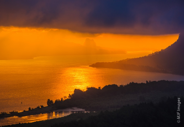 A beautiful sunrise over the Columbia River Gorge, with Beacon Rock just visible through the mist.
