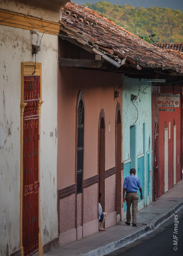Two residents of Granada, Nicaragua slow down on one of the city's back streets as the day does the same.