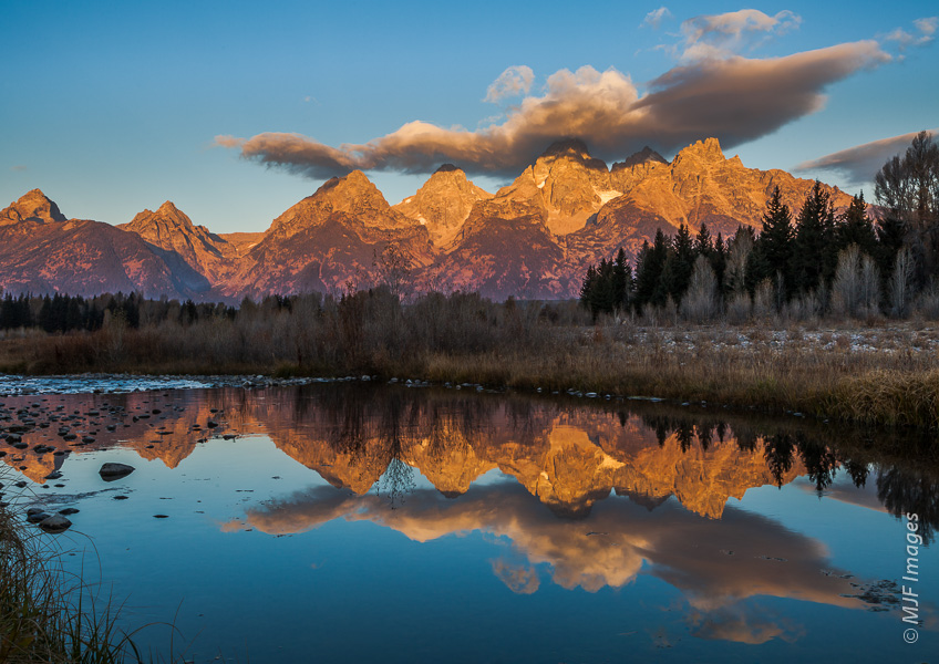 The Grand Tetons in Wyoming are reflected in the Snake River.