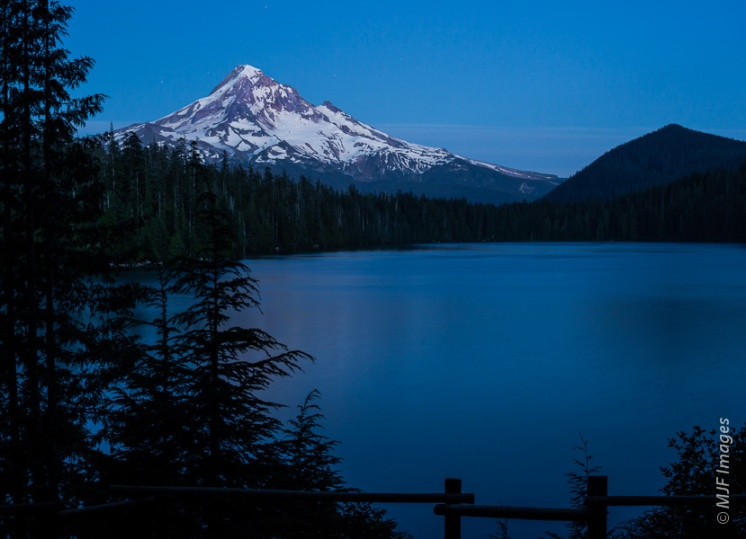 Mount Hood towers over Lost Lake after sunset.