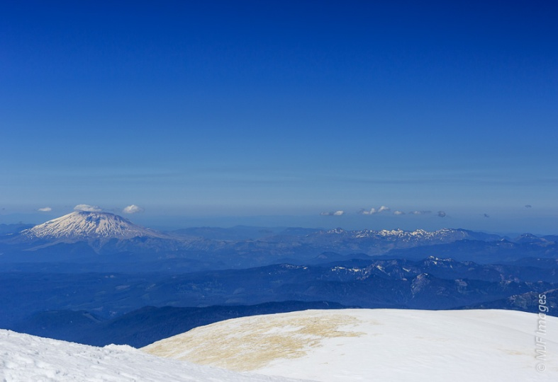 Mount St. Helens lies to the west as viewed from the summit of Mount Adams.