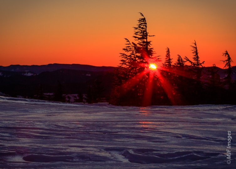 Snow reflects the setting sun from Timberline Lodge on Mount Hood, Oregon.