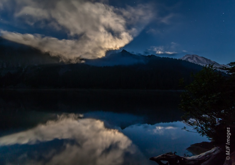 Much-needed light is provided by the moon's reflection from clouds in this evening shot from Mt. Rainier National Park