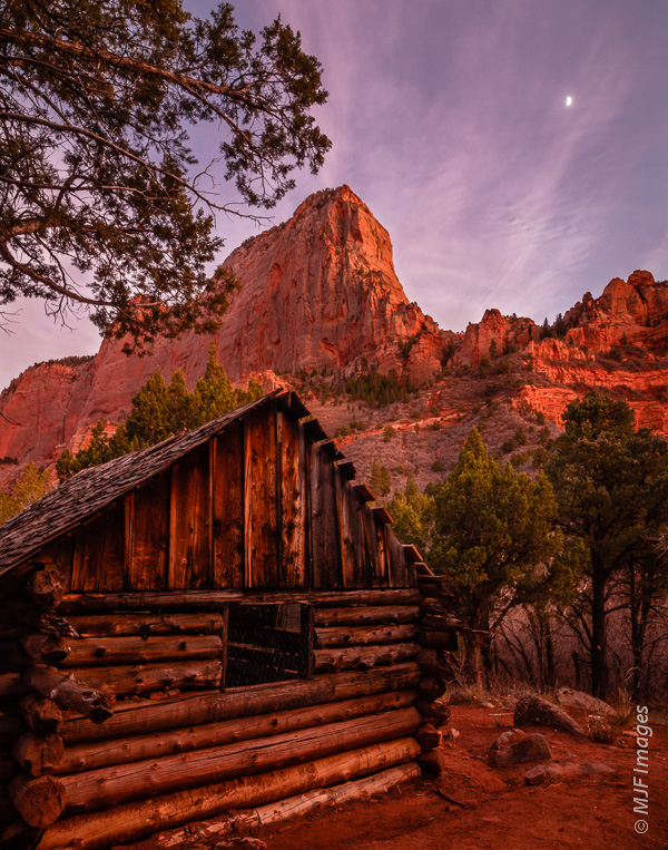 In this evening shot at Zion National Park, the old cabin takes on the color of the canyon walls after the sky's ambient light is reflected from them.