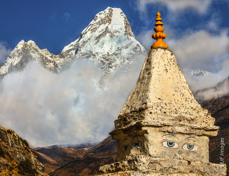 A small stupa in Nepal's Himalayan mountains allows Buddhists and non-Buddhists alike a moment of rest and reflection on the trekking trail.