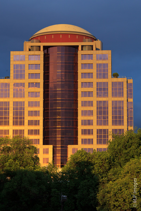 A building in downtown Portland reflects the golden light of the setting sun.