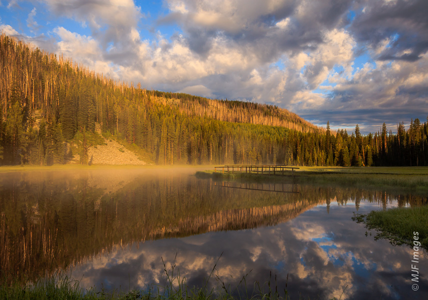 A calm wetland in the Montana Rockies greets the morning.