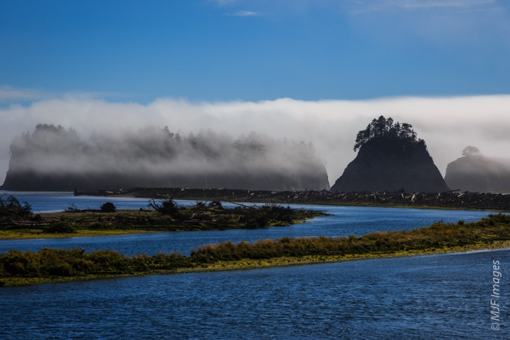 The mouth of the Quillayute River in Washington is marked by large sea stacks.