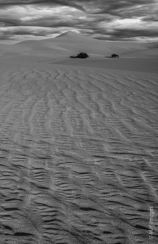 Death Valley, California.  Good detail in the foreground sand was most important here, and the background dunes were not as big a part of the image.  So I shot at f/16 and focused on the sand in front of me.