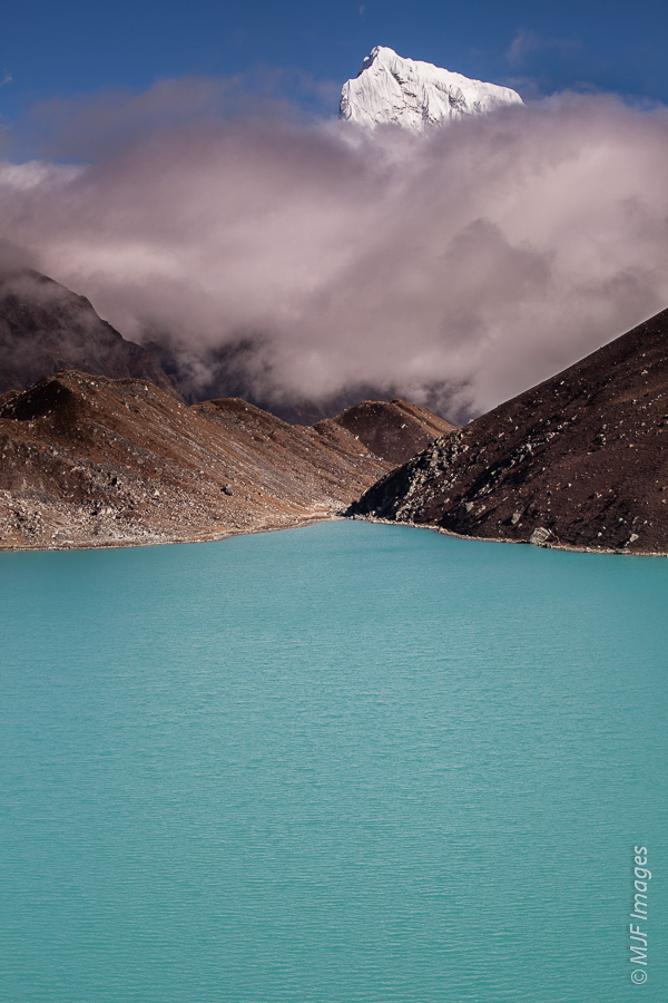 Gokyo Lake in Nepal.  I have another version where the lake waters have not been desaturated, as I did here to make it better negative space.