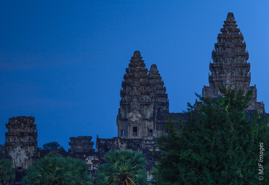 Night falls at Angkor Wat, Cambodia.  This negative space is in the left upper corner and probably could stand to be lightened a bit.