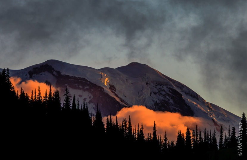 The last of the day's light falls on Mount Rainier in Washington.