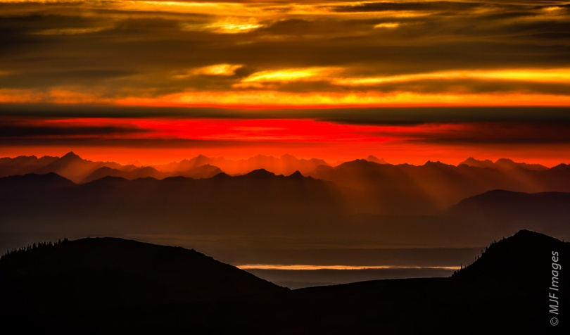 A rewarding sunrise from Hurricane Ridge in the Olympic Mountains highlights the peaks of the North Cascades in Washington.