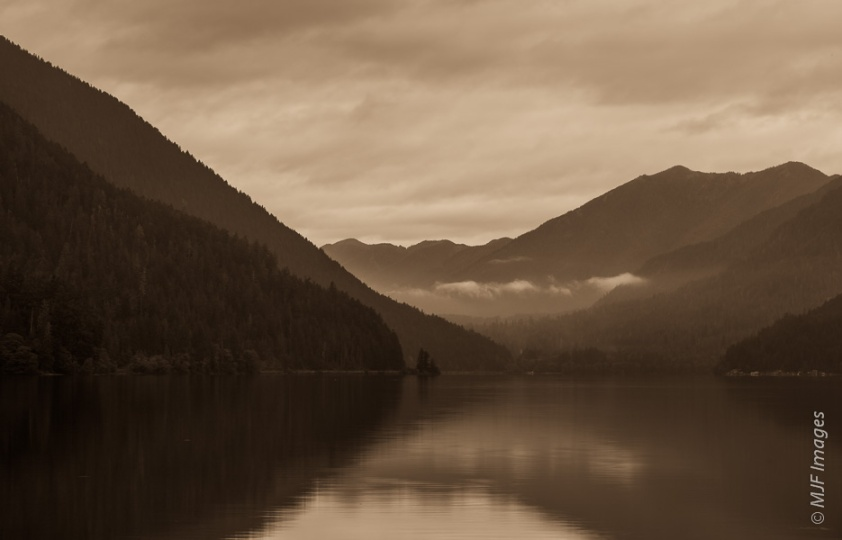 A beautiful lake on the northern Olympic Peninsula in Washington, Lake Crescent is calm here under cloudy skies.