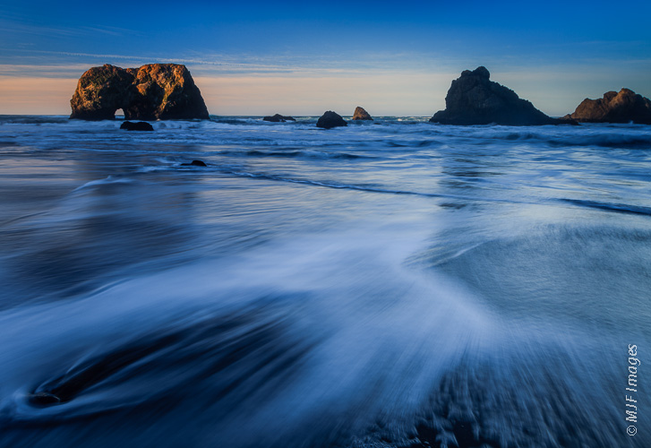 Northern California Coast, where a shutter speed of 0.6 seconds served to streak the incoming surf.  Worth the wet sneakers!