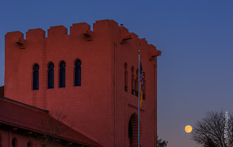 The moon rises over the Scottish Rite Cathedral in Santa Fe.