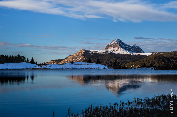 Engineer Mountain in Colorado's San Juan Mountains from a lake at 10,000 feet.