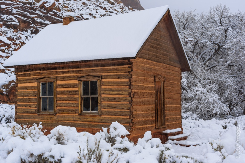 Morning reveals new-fallen snow in the old pioneer settlement of Fruita, Utah.  This is the one-room schoolhouse, which has been beautifully restored.
