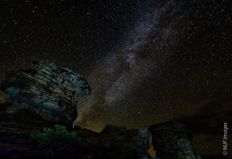 The Milky Way rises over rock formations in Canyonlands National Park, Utah.