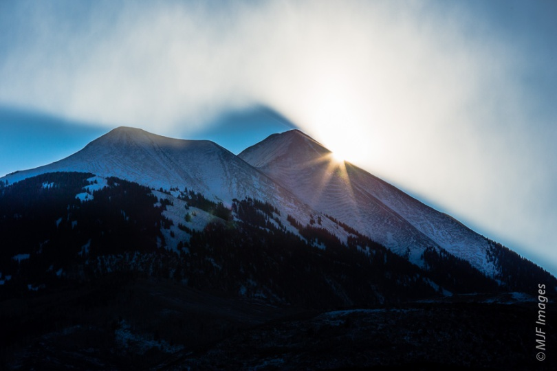 An unusual cloud formation over the La Sal Mountains (Utah) just as the sun was making its first appearance on a cold morning after snowfall overnight.