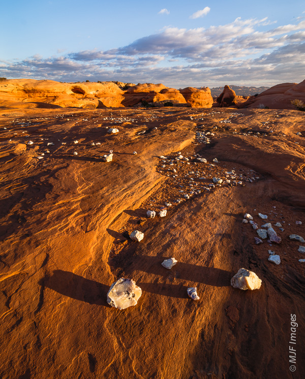 Various forms of quartz (jasper, opal, etc.) lie scattered on the sandstone & reward the exploring sort of photog.