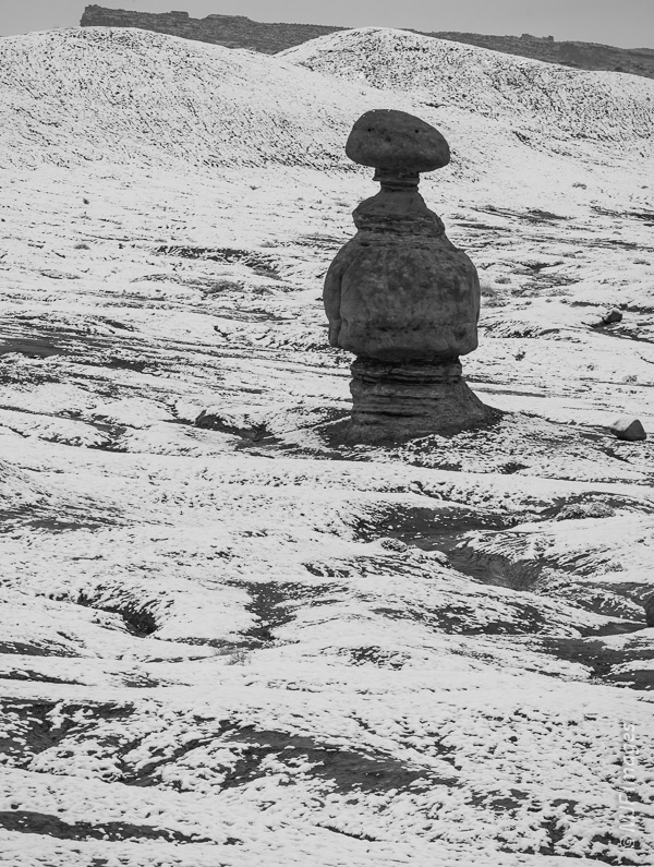 Alone in the snow, a rock formation in the weird Goblin Valley of southern Utah.