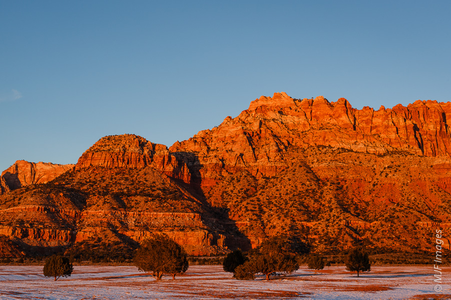 The Vermilion Cliffs near Colorado City, Arizona take on a russet color at sunset.