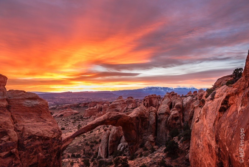 Good morning!  Dawn in Arches National Park over the world's longest natural stone arch, Landscape Arch.