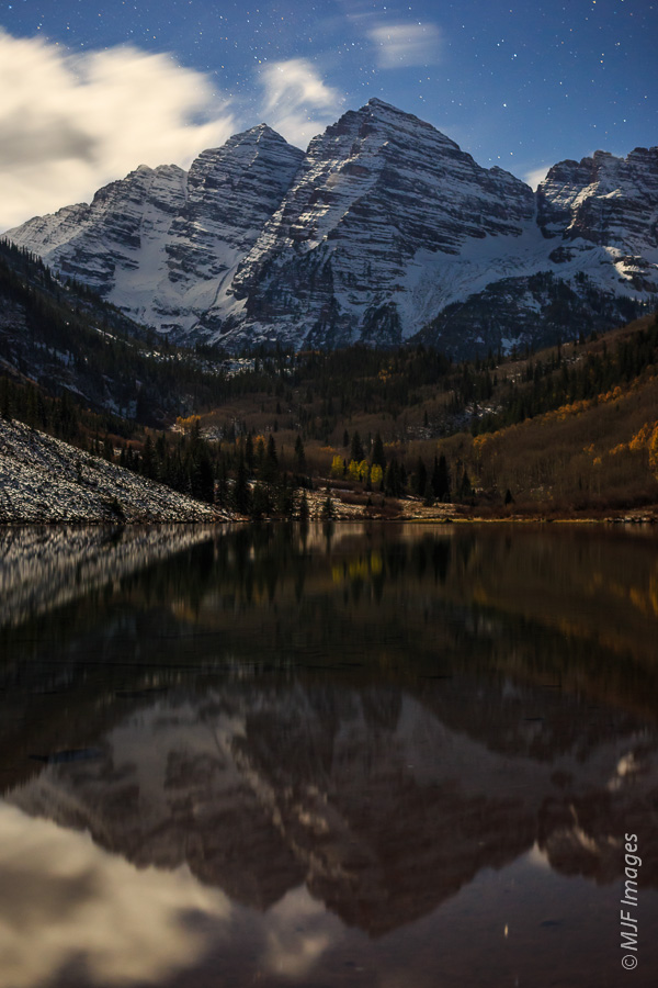 A full moon illuminates the Maroon Bells & Maroon Lake in the Colorado Rockies.