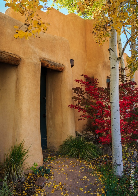 Welcome home:  A typically understated entrance to an adobe house in Taos, New Mexico.