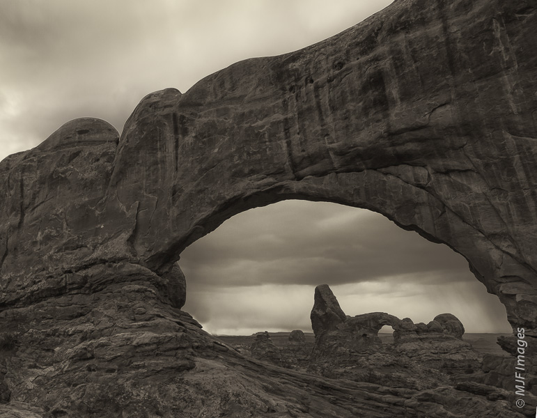The classic view of Turret Arch through North Window at Arches National Park, Utah.