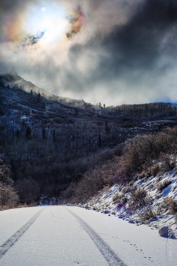 The drive over La Sal Mountain Loop Road near Moab, Utah can easily surprise with snow.