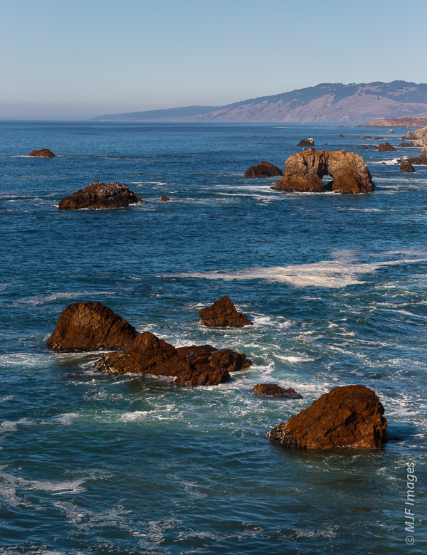 Rocks and surf as far as the eye can see.  Cape Mendocino is in the distance.