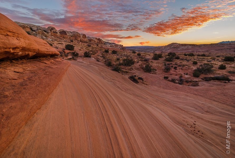 Dawn breaks over sandstone slickrock in southern Utah.  Protected by copyright.  Click image for purchase options