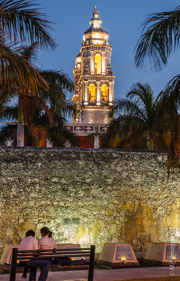A couple spends some time near the cathedral in Campeche on the Yucatan Peninsula, Mexico.