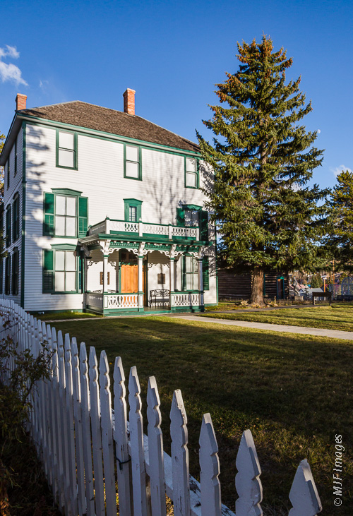 This house in Leadville, Colorado, registered as a historic landmark, is better placed with the foreground picket fence.