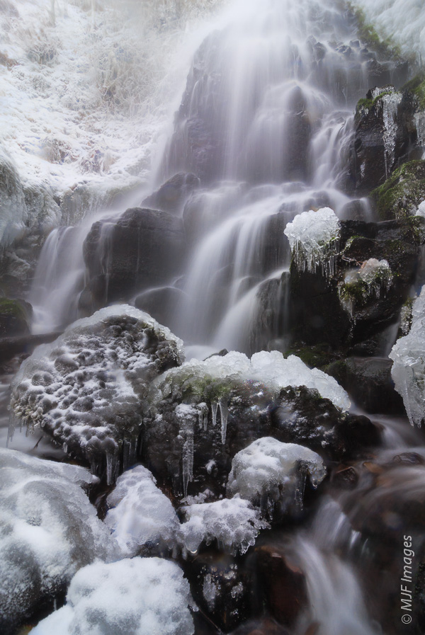 Beautiful Faery Falls in the Columbia River Gorge is nearly frozen over.well on the way to being frozen over.