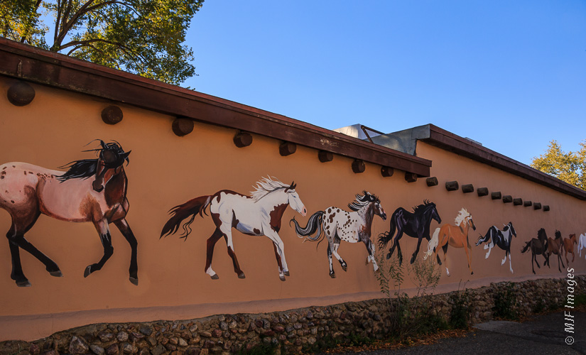 Sometimes the residents of an area have done the work for you.  Shooting public art like this mural in Taos, New Mexico can add to your image the sense of place felt by the artist.