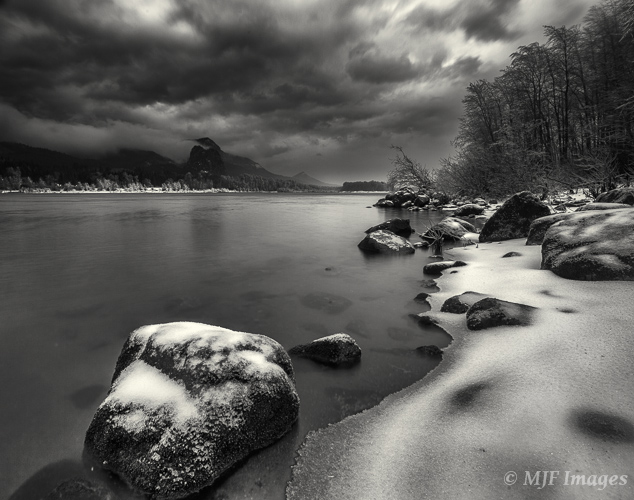 An angry sky in the Columbia River Gorge develops as a warm moist front moves in right after a day of snow and freezing rain.