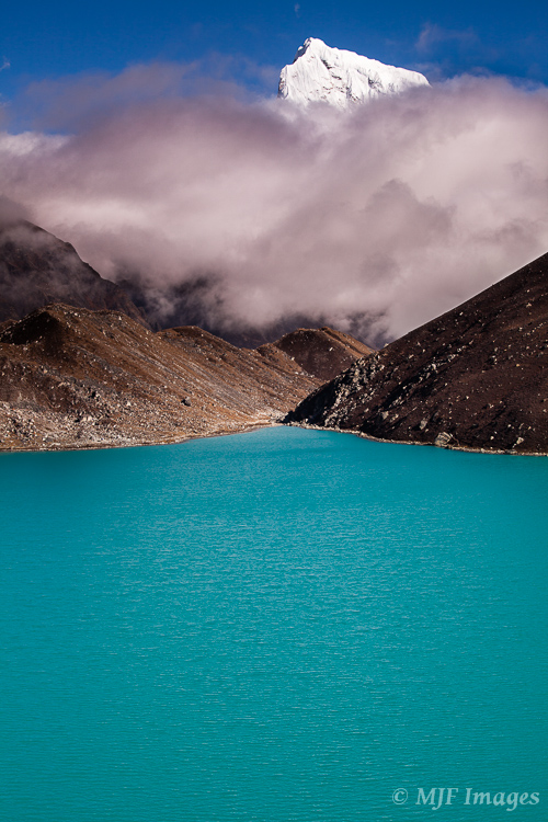 Gokyo Lake in Nepal has that distinctive color that only glacial lakes can have.