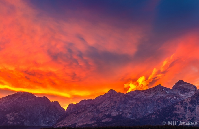 The Grand Tetons in Wyoming appear to have caught fire just after an autumn sunset.