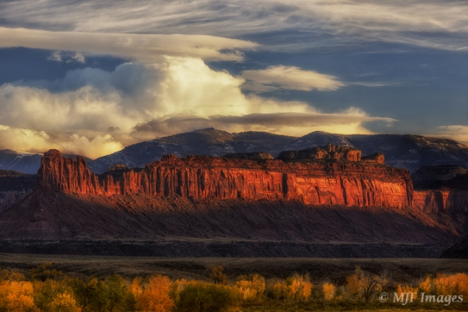 In this image from the Canyonlands area, Utah, layered clouds help to highlight the layers of color in the landscape.