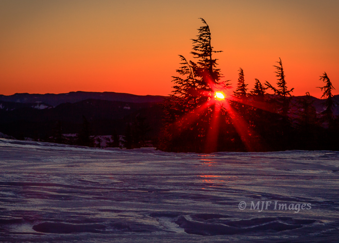 A winter sunset from Timberline on Mount Hood, Oregon reflects from the snow.